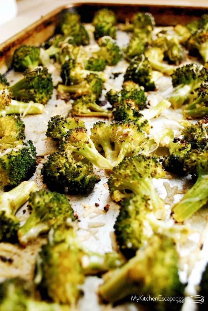Cookie sheet full of garlic parmesan roasted broccoli