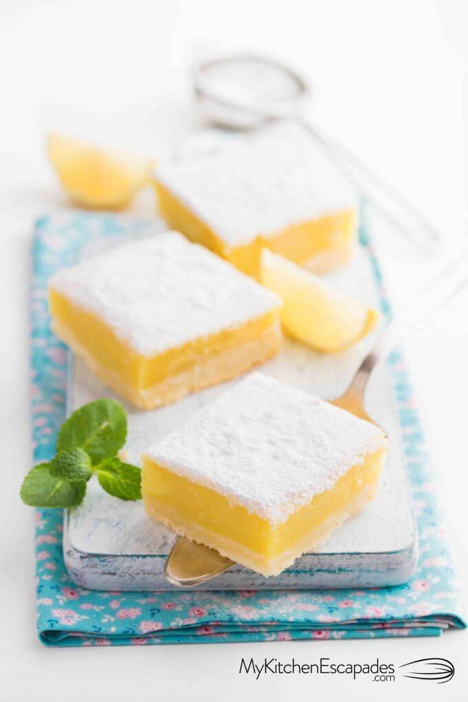 three homemade lemon bars on a platter