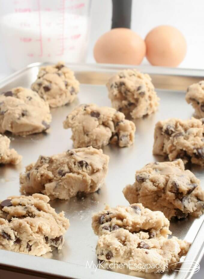 cookie sheet with scoops of raw dough