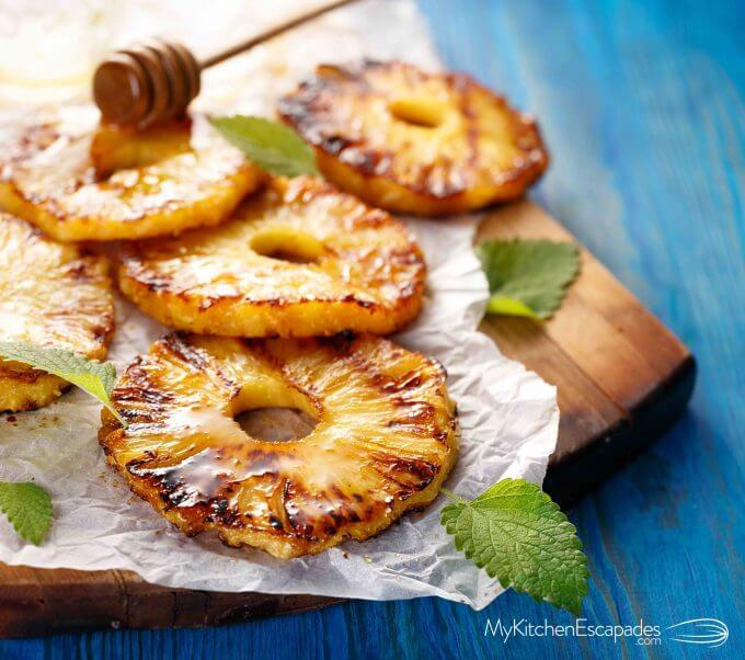 sliced grilled pineapple with honey drizzle