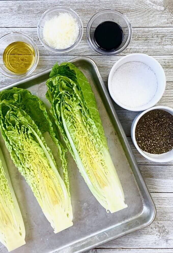 Pan of romaine hearts with oil, cheese, and seasonings