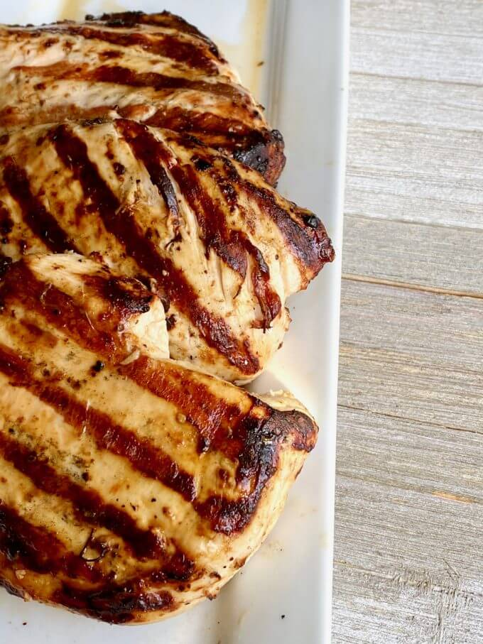 3 grilled chicken breasts on a plate