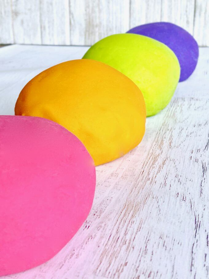 pink orange green and purple play dough balls