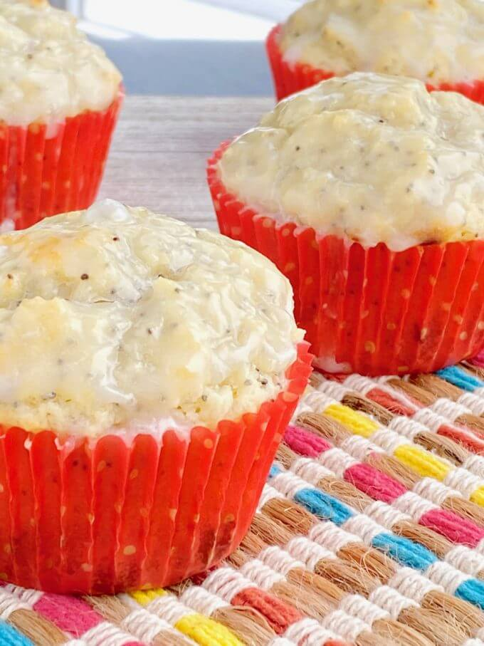 Up close of lemon poppyseed muffins in red muffin liners