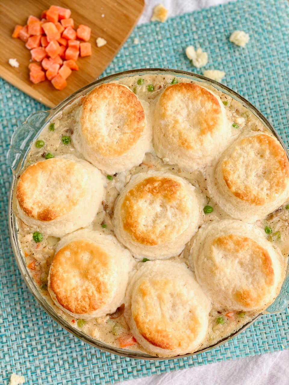 Overhead shot of chicken pot pie with biscuits on top