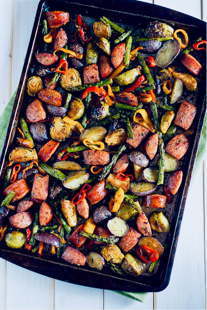 cookie sheet of smoked sausage and roasted vegetables
