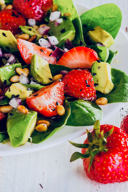 spinach salad with strawberries, avocado, and poppyseed dressing